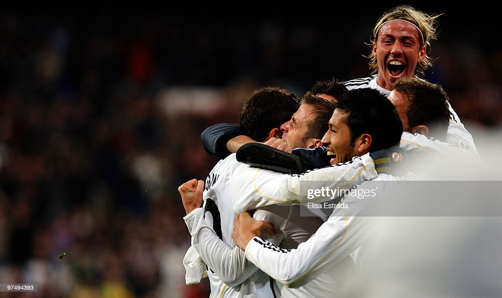 Rafael Van der Vaart (2nd L) of Real Madrid celebrates his goal with <a gi-track='captionPersonalityLinkClicked' href=/galleries/search?phrase=Ezequiel+Garay&family=editorial&specificpeople=857797 ng-click='$event.stopPropagation()'>Ezequiel Garay</a> (R) and Guti (TOP) during the La Liga match between Real Madrid and Sevilla at Estadio Santiago Bernabeu on March 6, 2010 in Madrid, Spain. (Photo by Elisa Estrada/Real Madrid via Getty Images).