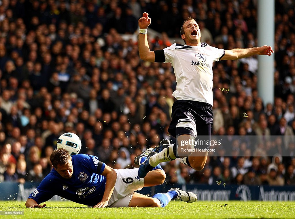 Rafael van der Vaart of Tottenham is brought down by <a gi-track='captionPersonalityLinkClicked' href=/galleries/search?phrase=Phil+Jagielka&family=editorial&specificpeople=682518 ng-click='$event.stopPropagation()'>Phil Jagielka</a> of Everton during the Barclays Premier League match between Tottenham Hotspur and Everton at White Hart Lane on October 23, 2010 in London, England.