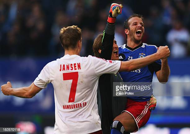 Rafael van der Vaart Rene Adler and Marcell Jansen of Hamburg celebrate after winning the Bundesliga match between Hamburger SV and Borussia Dortmund...