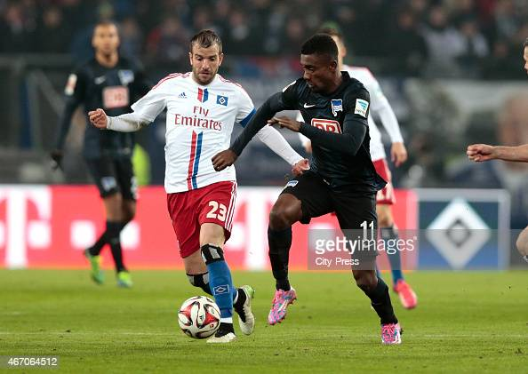 Rafael van the Vaart of Hamburger SV and Salomon Kalou of Hertha BSC battle for the ball during the match between Hamburger SV and Hertha BSC on...