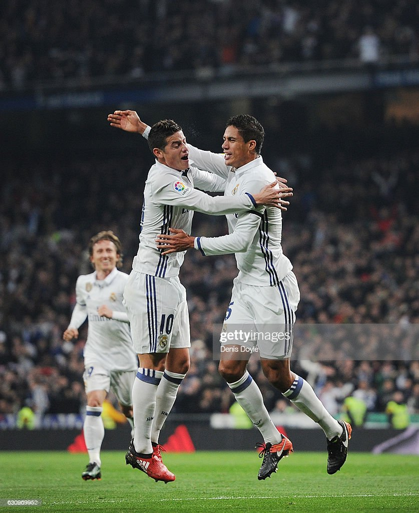 Rafael Varane of Real Madrid celebrates with James Rodriguez after scoring Real's 2nd goal during the Copa del Rey Round of 16 First Leg match between Real Madrid and Sevilla at Bernabeu on January 4, 2017 in Madrid, Spain.