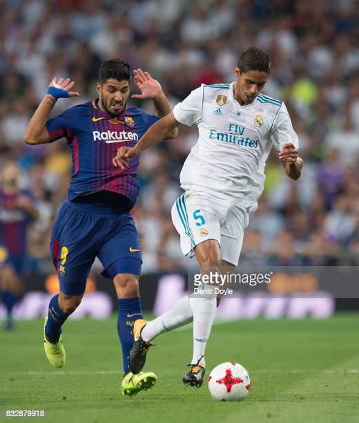Rafael Varane of Real Madrid CF outruns Luis Suarez of FC Barcelona during the Supercopa de Espana Final 2nd Leg match between Real Madrid and FC...