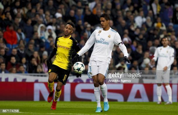 Rafael Varane of Real Madrid in action against PierreEmerick Aubameyang of Borussia Dortmund during the UEFA Champions League group H match between...