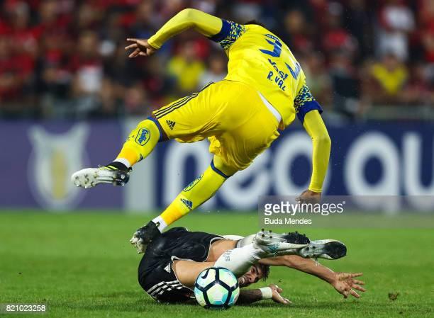 Rafael Vaz of Flamengo struggles for the ball with Henrique Almeida of Coritiba during a match between Flamengo and Coritiba as part of Brasileirao...