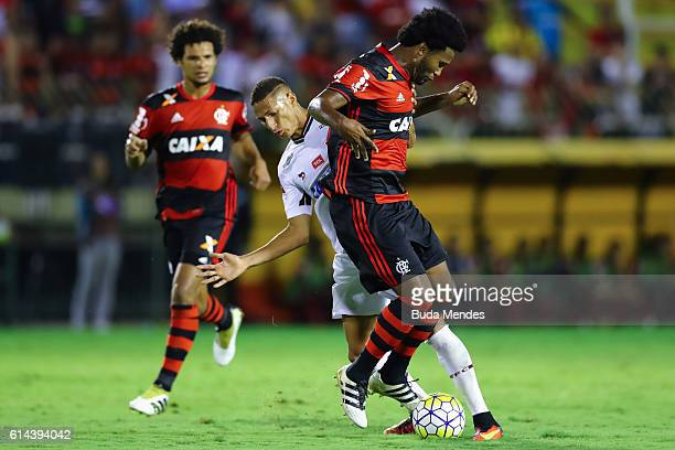 Rafael Vaz of Flamengo struggles for the ball with Richarlison of Fluminense during a match between Fluminense and Flamengo as part of Brasileirao...