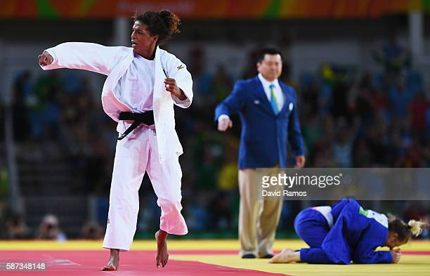 Rafaela Silva of Brazil celebrates after defeating Corina Caprioriu of Romania in the Women's 57 kg Semifinal of Table B Judo contest on Day 3 of the...