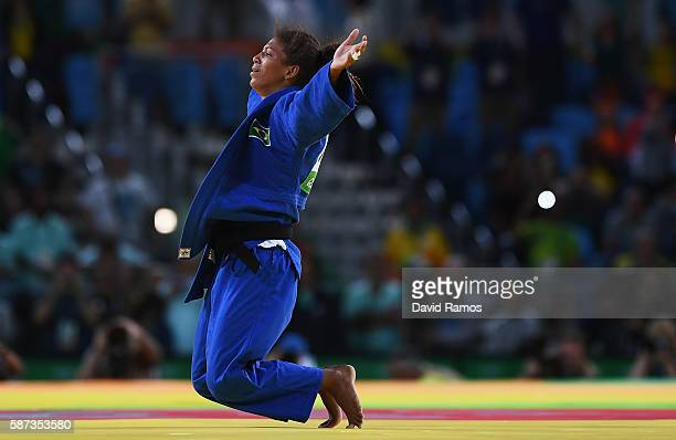 Rafaela Silva of Brazil celebrates after defeating Sumiya Dorjsuren of Mongolia in the Women's 57 kg Final Gold Medal Contest on Day 3 of the Rio...