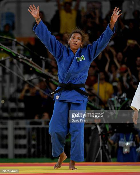 Rafaela Silva of Brazil celebrates defeating Sumiya Dorjsuren of Mongolia to win the u57kg gold medal during day 3 of the 2016 Rio Olympic Judo on...
