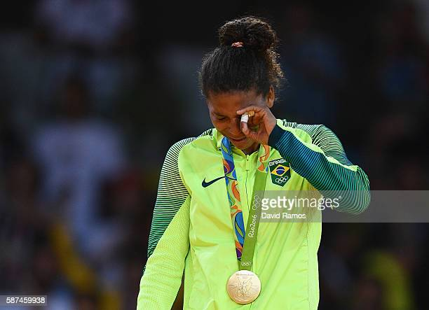 Rafaela Silva of Brazil celebrates on the podium after winning the gold medal in the Women's 57 kg Final Gold Medal Contest on Day 3 of the Rio 2016...