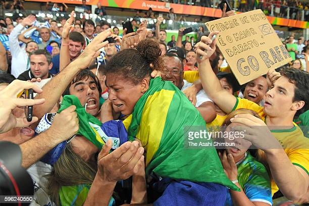 Rafaela Silva of Brazil celebrates winning the gold medal after competing in the Women's 57kg on Day 3 of the Rio 2016 Olympic Games at Carioca Arena...