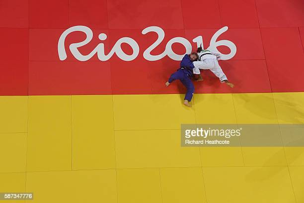 Rafaela Silva of Brazil competes against Corina Caprioriu of Romania in the Women's 57 kg Semifinal of Table B Judo contest on Day 3 of the Rio 2016...
