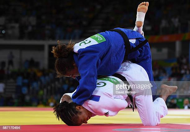 Rafaela Silva of Brazil takes down Miryam Roper of Germany in the Women's 57 kg Judo elimination round on Day 3 of the Rio 2016 Olympic Games at...