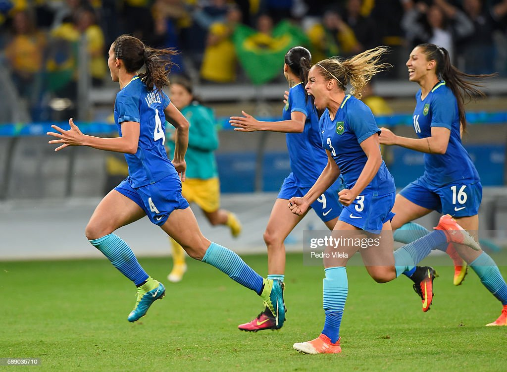 Rafaelle Monica Beatriz and Andressa Alves of Brazil celebrate their 00 win over Australia during the Women's Football Quarterfinal match at Mineirao...