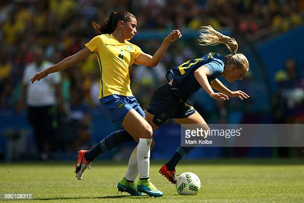 Rafaelle of Brazil and Olivia Schough of Sweden in action during the Women's Football Semi Final between Brazil and Sweden on Day 11 of the Rio 2016...