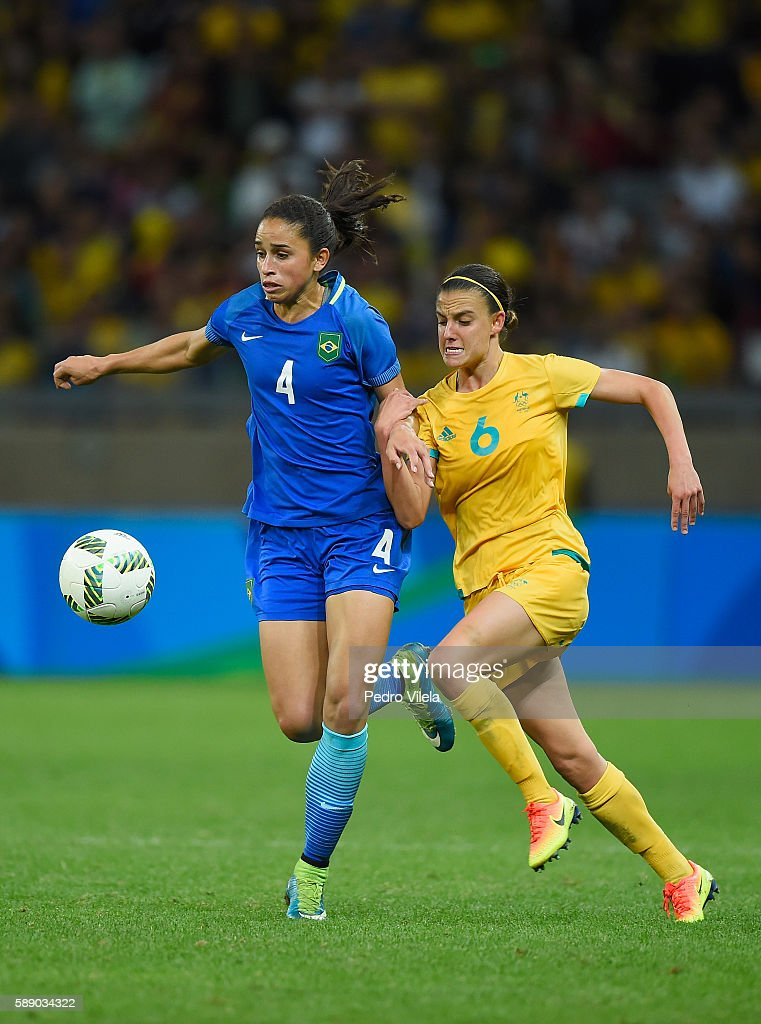 Rafaelle of Brazil controls the ball against Chloe Logarzo of Australia in extra time during the Women's Football Quarterfinal match at Mineirao...