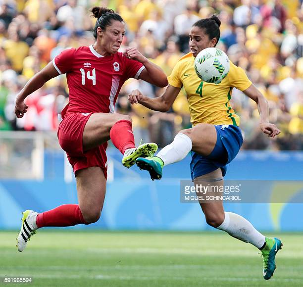 TOPSHOT Rafaelle of Brazil vies for the ball with Melissa Tancredi of Canada during their Rio 2016 Olympic Games women's bronze medal football match...