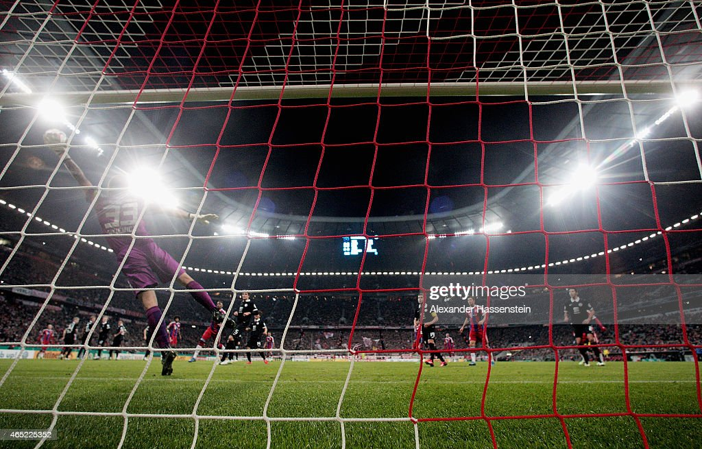 Rafal Gikiewicz of Eintracht Braunschweig stretches for the ball as David Alaba of FC Bayern Muenchen scores the opening goal during the round of 16...