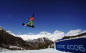 Rafal SkarbekMalczewski of Poland competes during the Mens Snowboard Cross Final on Day 6 of the 2006 Turin Winter Olympic Games on February 16 2006...