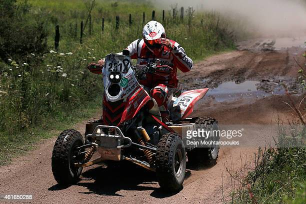 Rafal Sonik of Poland for Sonik Team on the YFM700R Raptor Yamaha gives the media a salute as he competes during Stage 12 on day 13 of the Dakar...