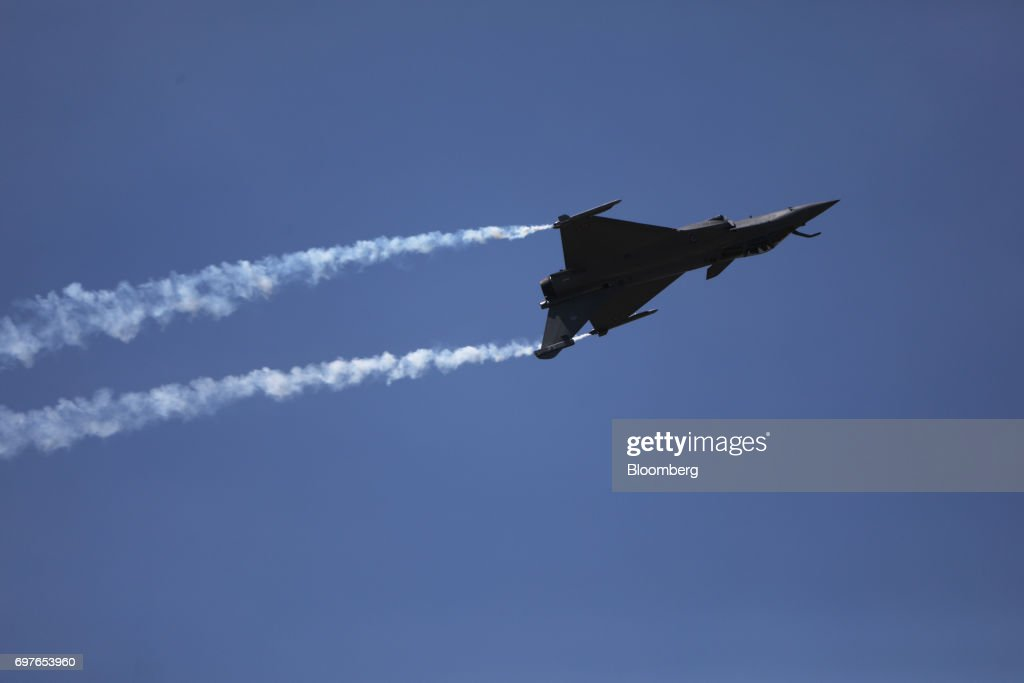A Rafale fighter jet, manufactured by Dassault Aviation SA, performs maneuvers during an aerobatic flying display at the 53rd International Paris Air Show at Le Bourget, in Paris, France, on Monday, June 19, 2017. The show is the world's largest aviation and space industry exhibition and runs from June 19-25. Photographer: Chris Ratcliffe/Bloomberg via Getty Images