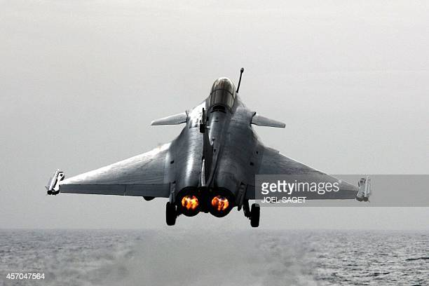 A Rafale French fighter plane takes off on the French aircraft carrier Charles De Gaulle on February 5 2009 in the Mediteranean After a technical...