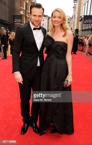 Rafe Spall and Elize du Toit arrive at The Laurence Olivier Awards 2013 at The Royal Opera House on April 28 2013 in London England