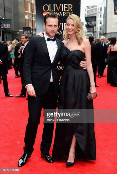 Rafe Spall and Elize du Toit attend The Laurence Olivier Awards at the Royal Opera House on April 28 2013 in London England