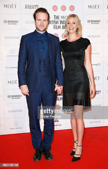Rafe Spall and Elize du Toit attend The Moet British Independent Film Awards at Old Billingsgate Market on December 7 2014 in London England