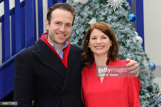 Rafe Spall and Jodie Whittaker attend a photocall for 'Get Santa' at Battersea Dogs Cats Home on December 1 2014 in London England