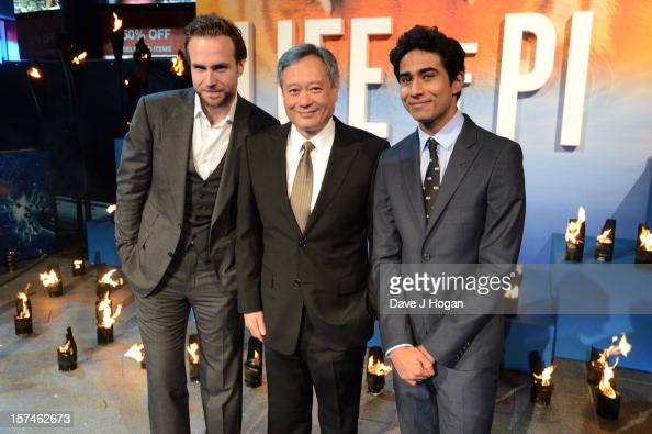 Rafe Spall Ang Lee and Suraj Sharma attend the UK premiere of 'Life Of Pi' at The Empire Leicester Square on December 3 2012 in London England