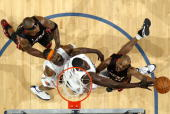 Rafer Alston of the Miami Heat shoots a layup against DeSagana Diop and Gerald Wallace of the Charlotte Bobcats during the game at Time Warner Cable...