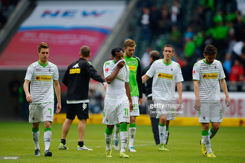Raffael and Julian Korb of Borussia Moenchengladbach look dejected after the Bundesliga match between Borussia Moenchengladbach and VfB Stuttgart at Borussia-Park on April 12, 2014 in Moenchengladbach, Germany.