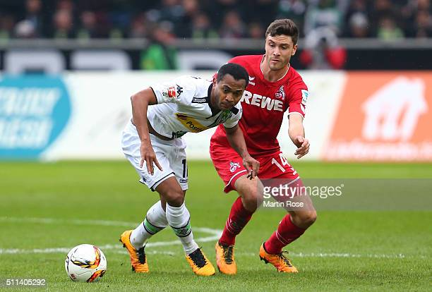 Raffael Caetano de Araujo of Borussia Moenchengladbach and Jonas Hector of Koeln compete for the ball during the Bundesliga match between Borussia...