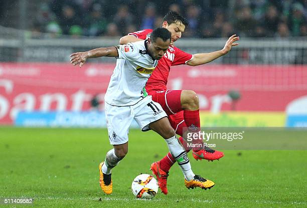 Raffael Caetano de Araujo of Borussia Moenchengladbach and Philipp Hosiner of Koeln compete for the ball during the Bundesliga match between Borussia...
