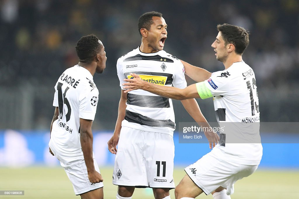 Raffael Caetano de Araujo of Borussia Moenchengladbach celebrates his goal with Ibrahima Traore and Lars Stindl of Borussia Moenchengladbach during...