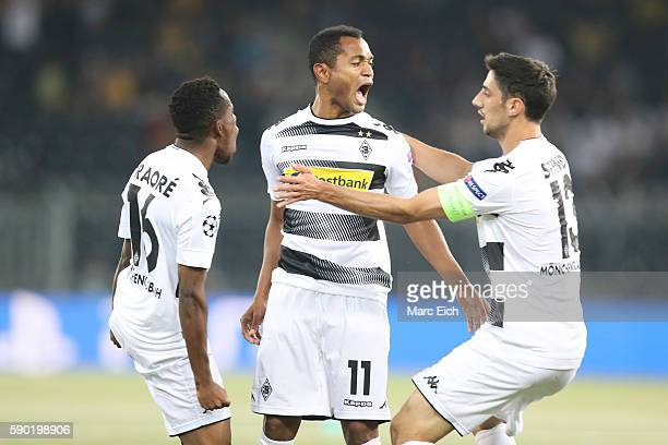 Raffael Caetano de Araujo of Borussia Moenchengladbach celebrates his goal with Ibrahima Traore and Lars Stindl of Borussia Moenchengladbach during...
