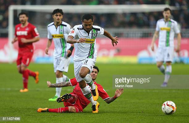 Raffael Caetano de Araujo of Borussia Moenchengladbach is tackled by Leonardo Jesus Bittencourt of Koeln during the Bundesliga match between Borussia...