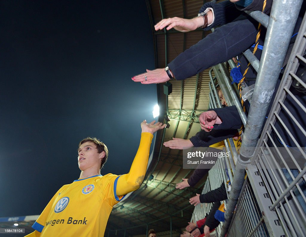 Raffael Korte of Braunschweig celebrates with the fans at the end of the Second Bundesliga match between Eintracht Braunschweig and1. FC Union Berlin at the eintracht stadium on December 17, 2012 in Braunschweig, Germany.