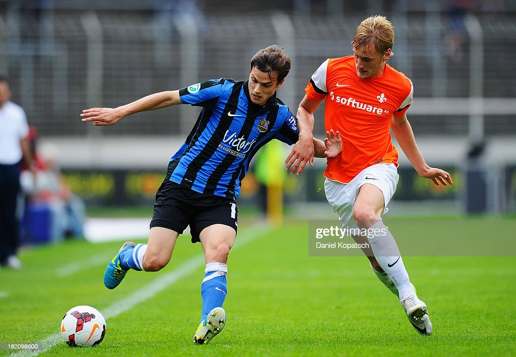 Raffael Korte of Saarbruecken (L) is challenged by Hanno Behrens of Darmstadt during the third Bundesliga match between 1. FC Saarbruecken and Darmstadt 98 on September 28, 2013 in Saarbruecken, Germany.