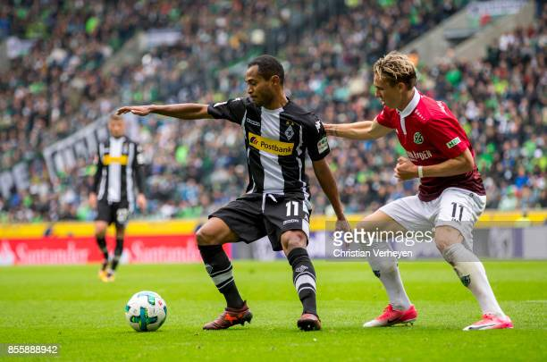 Raffael of Borussia Moenchengladbach and Felix Klaus of Hannover 96 battle for the ball during the Bundesliga match between Borussia Moenchengladbach...