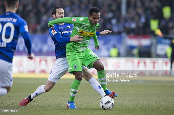 Raffael of Borussia Moenchengladbach and Mario Vrancic of SV Darmstadt battle for the ball during the Bundesliga Match between SV Darmstadt 98 and...