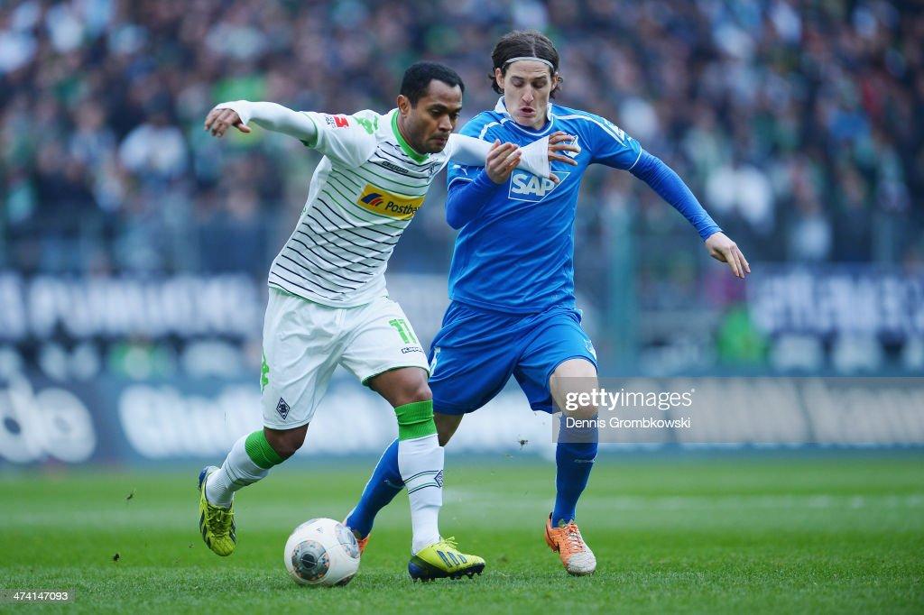 Raffael of Borussia Moenchengladbach and Sebastian Rudy of 1899 Hoffenheim battle for the ball during the Bundesliga match between Borussia...