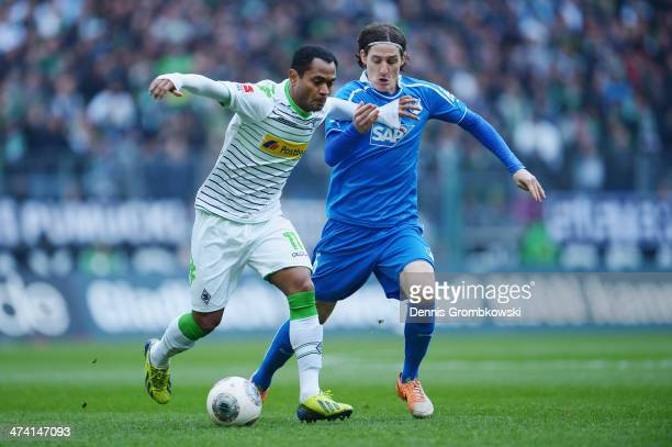 Raffael of Borussia Moenchengladbach and Sebastian Rudy of 1899 Hoffenheim battle for the ball during the Bundesliga match between Borussia...