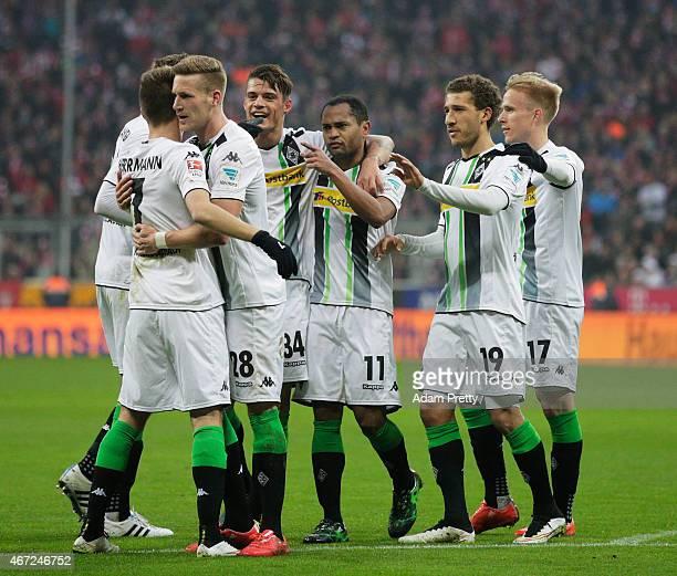 Raffael of Borussia Moenchengladbach celebrates after scoring the first goal during the Bundesliga match between Bayern Muenchen and Borussia...