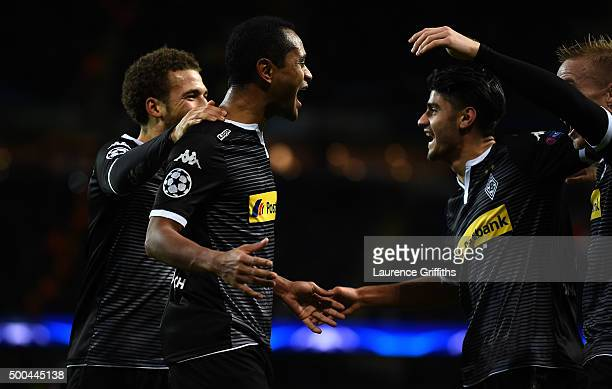Raffael of Borussia Moenchengladbach celebrates with his team mates after scoring his side's second goal during the UEFA Champions League Group D...