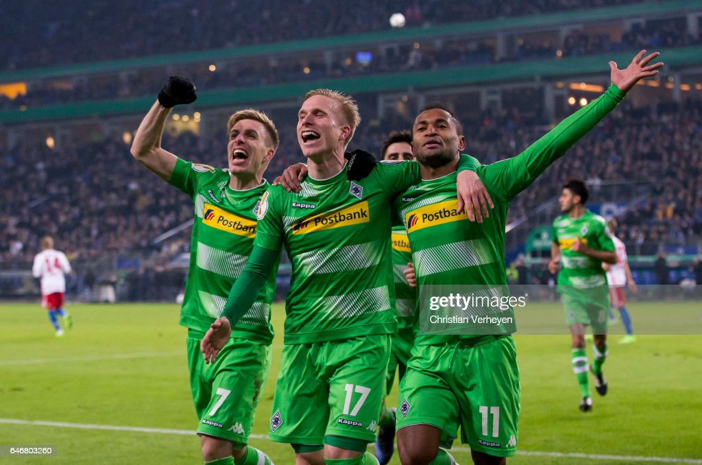 Raffael of Borussia Moenchengladbach celebrates with his team mates Oscar Wendt and Patrick Herrmann after he scores his teams second goal during the DFB Cup match between Hamburger SV and Borussia Moenchengladbach at Volksparkstadion on March 01, 2017 in Hamburg, Germany.