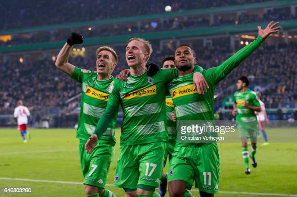 Raffael of Borussia Moenchengladbach celebrates with his team mates Oscar Wendt and Patrick Herrmann after he scores his teams second goal during the...