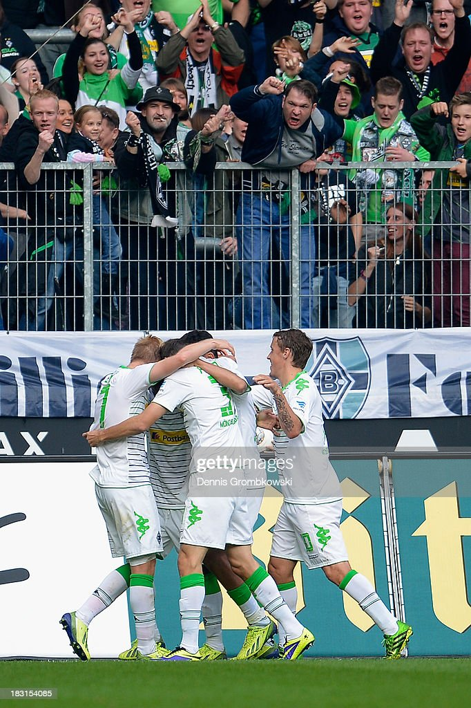 Raffael of Borussia Moenchengladbach celebrates with teammates after scoring the second goal during the Bundesliga match between Borussia Moenchengladbach and Borussia Dortmund at Borussia-Park on October 5, 2013 in Moenchengladbach, Germany.
