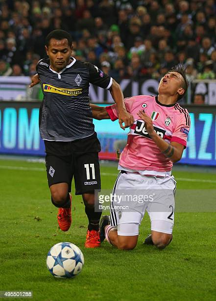 Raffael of Borussia Moenchengladbach clashes with Paul Dybala of Juventus during the UEFA Champions League Group D match between VfL Borussia...