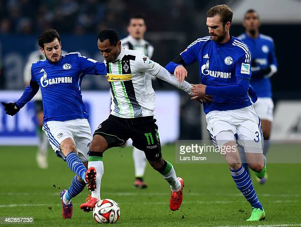 Raffael of Borussia Moenchengladbach is challenged by Tranquillo Barnetta of Schalke 04 and Jan Kirchhoff of Schalke 04 during the Bundesliga match...